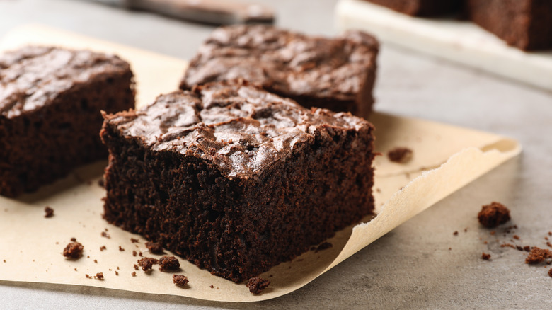 chocolate brownies on parchment paper
