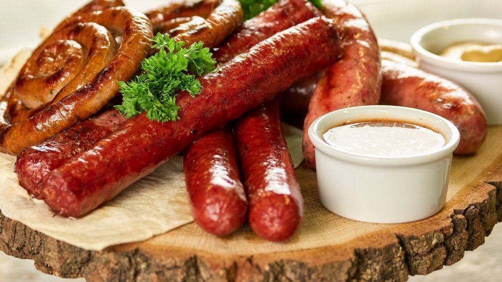 Sausages on a chopping board