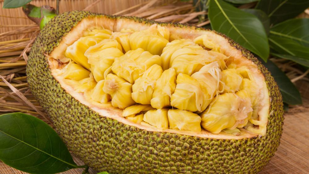 Open jackfruit showing interior bulbs