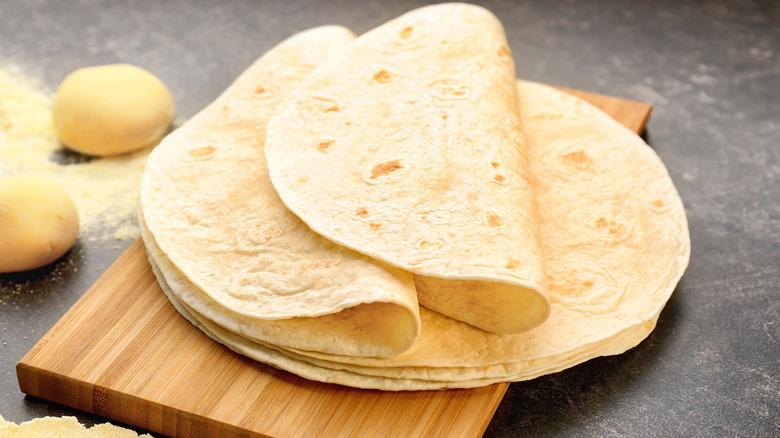 Flour tortillas on a wood cutting board