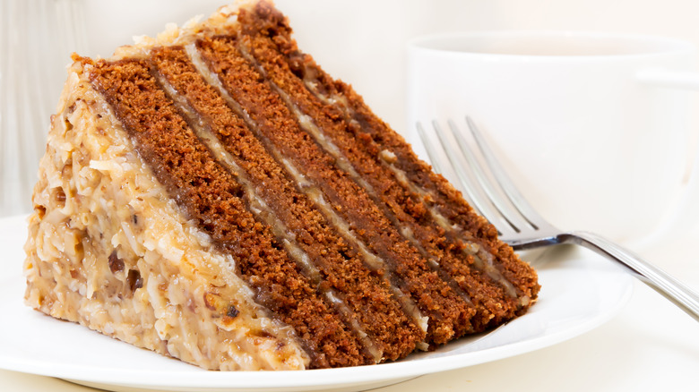 Slice of German chocolate cake next to fork