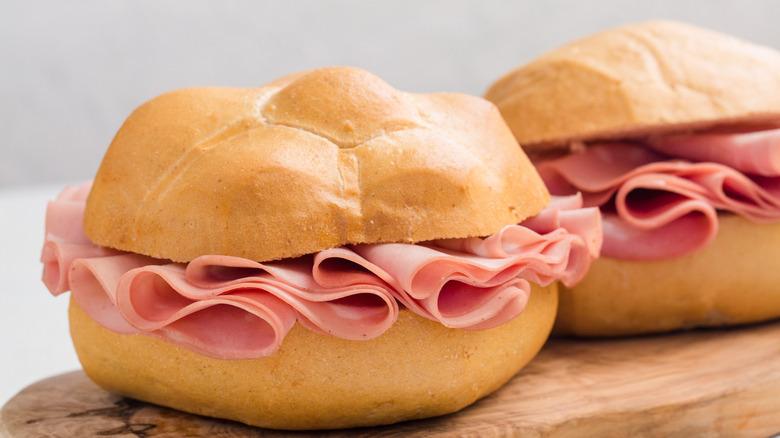 Mortadella sandwiches atop wooden board