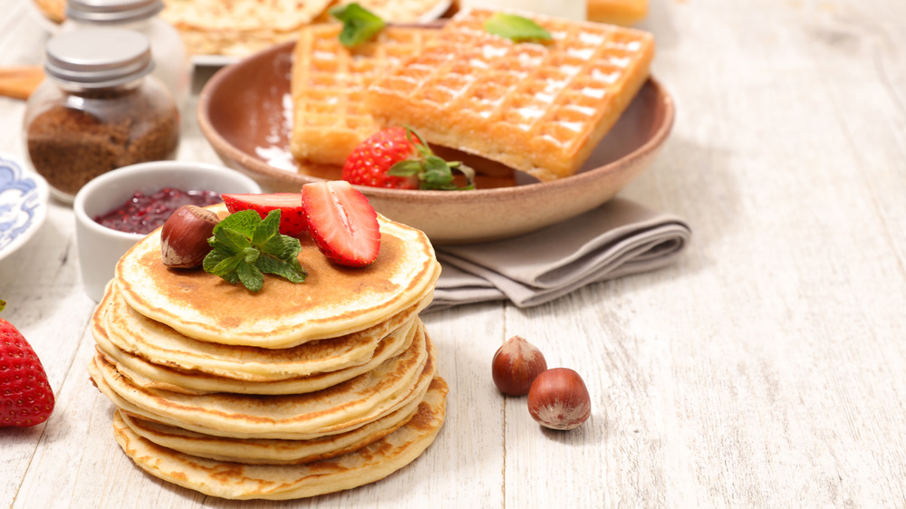 Fruit-topped pancakes and sugary waffles