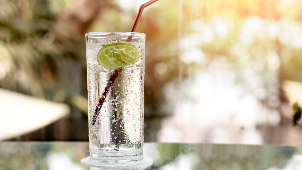 Glass of seltzer with lime