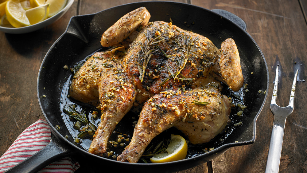 Spatchcocked chicken in a cast-iron pan