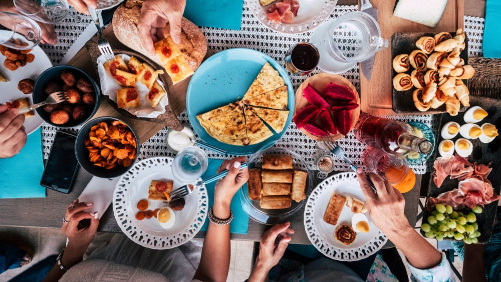 Brunch spread with eggs, potatoes, pastries and frittatas