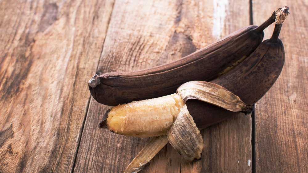 overripe bananas against a wood background