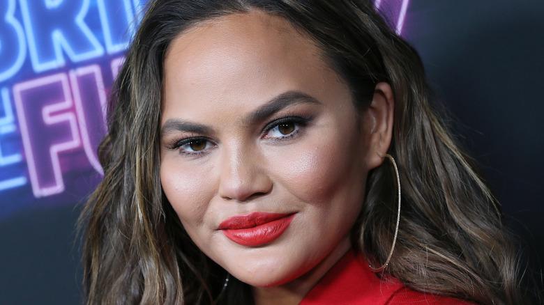 Chrissy Teigen, bright red lipstick