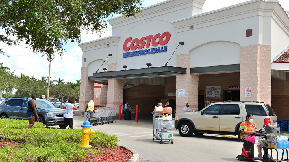 People with full carts leaving Costco