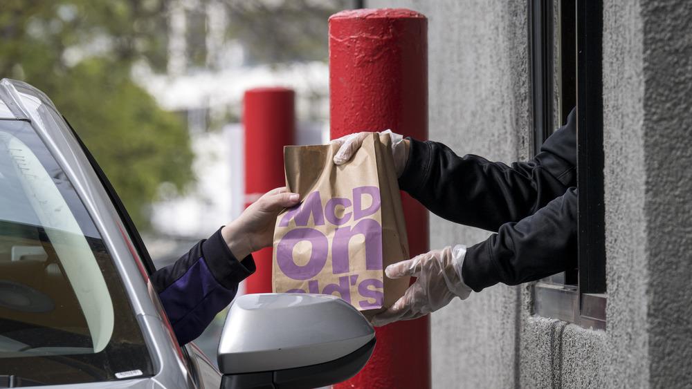 Handing fast food in a drive thru