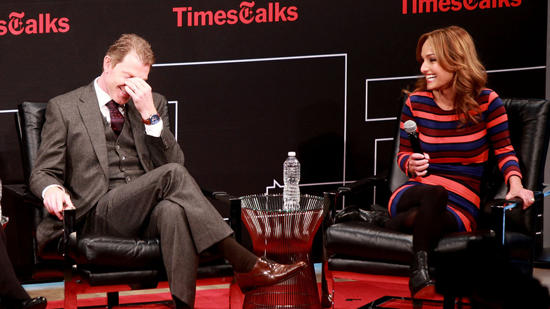 Bobby Flay and Giada De Laurentiis laughing