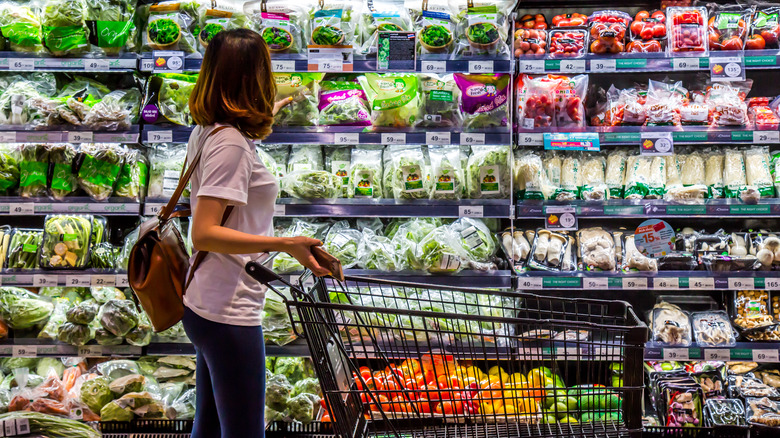 Person looking at produce section of grocery store