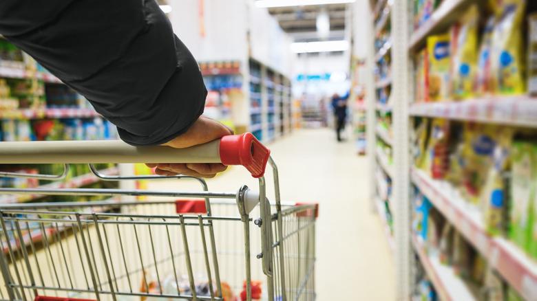 Shopper walks with a cart