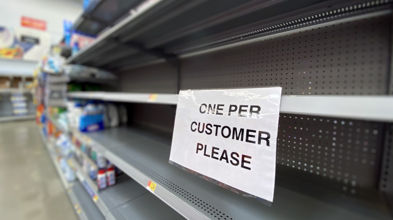 empty shelf with sign limiting amount of item customers can buy