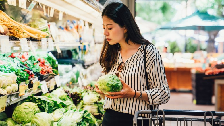woman shopping for grocery store produce