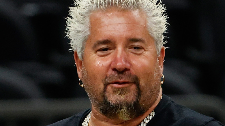 Guy Fieri wearing sparkly necklace