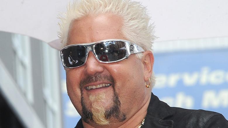 Guy Fieri in silver sunglasses
