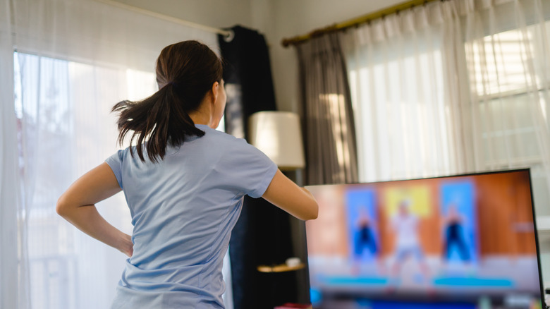 Woman exercising indoors