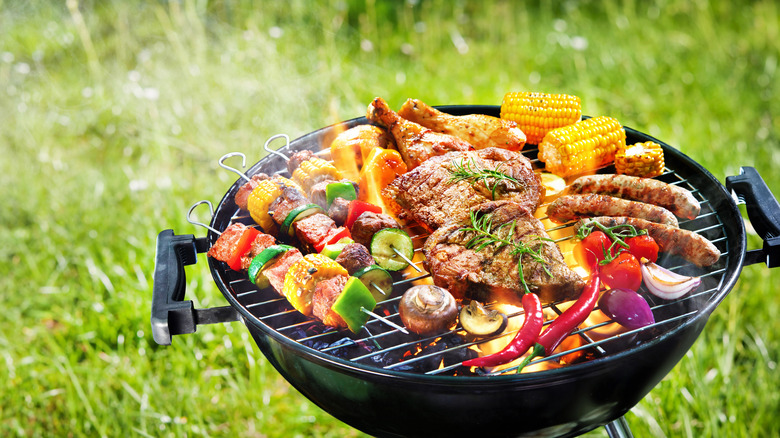 Grill with chicken and vegetables on top