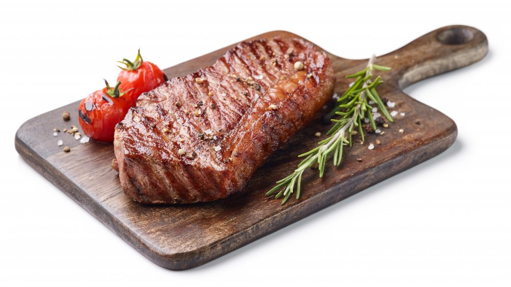 Grilled steak on a wooden board