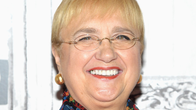 Lidia Bastianich smiles with glasses and red lipstick