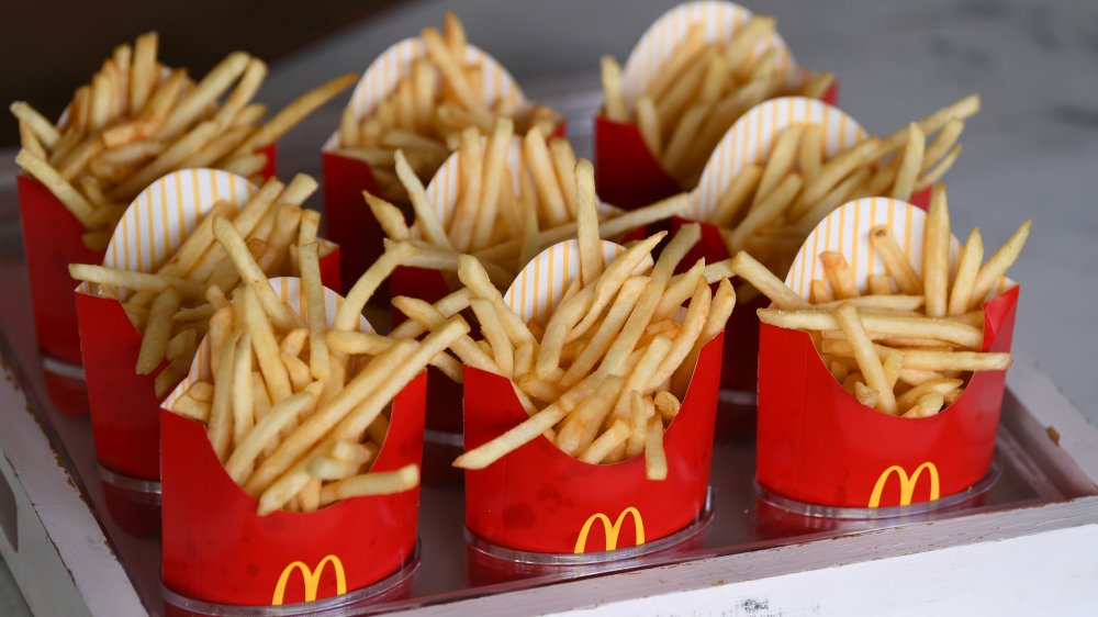 Many boxes of McDonald's French Fries