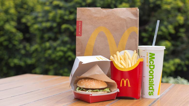 McDonalds bag and food on a table.