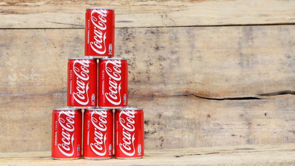 coke cola cans stacked