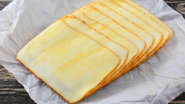 Slices of Muenster cheese