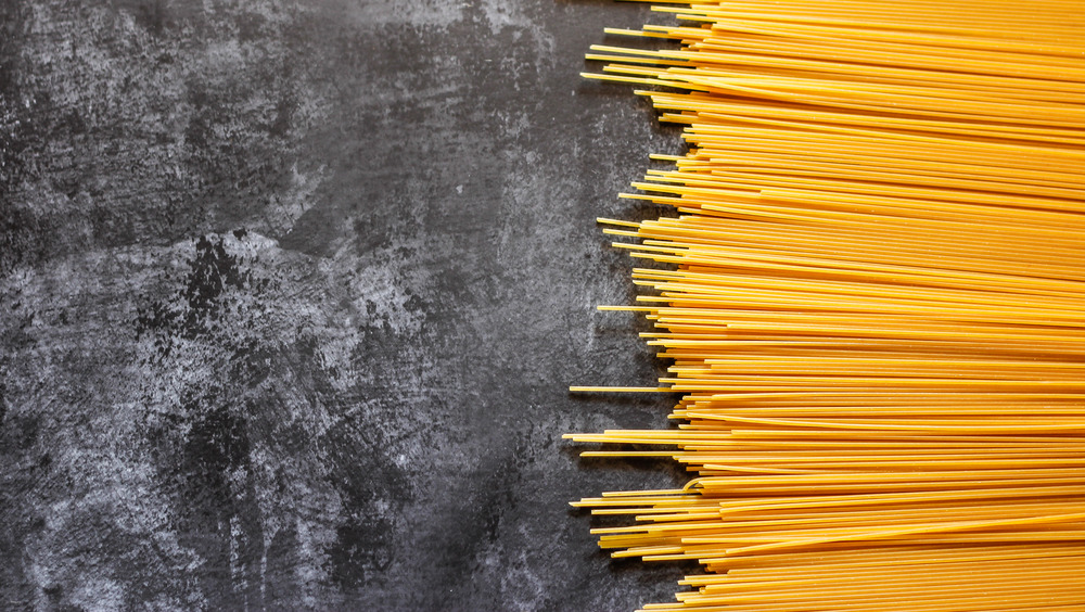 Yellow pasta on a black background