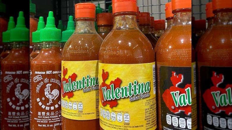 Bottles of Valentina hot sauce on store shelf
