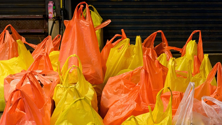 Orange and yellow plastic shopping bags