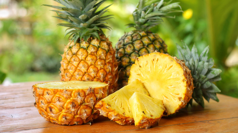 Several pineapples on a table