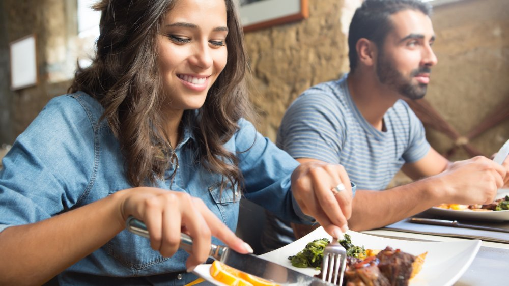 Couple dining in restaurant