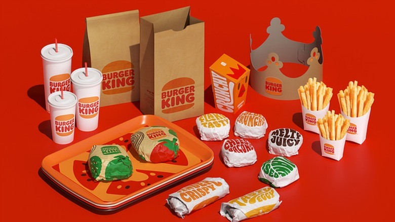 Assorted Burger King products with new branding on red background