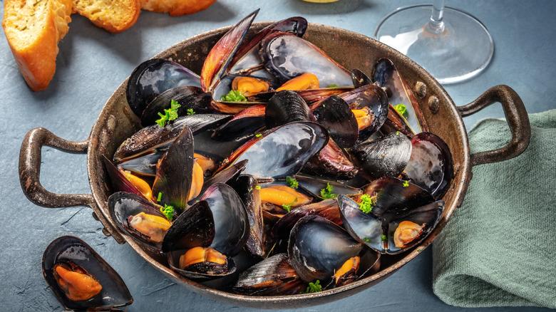 Fresh mussels in pan