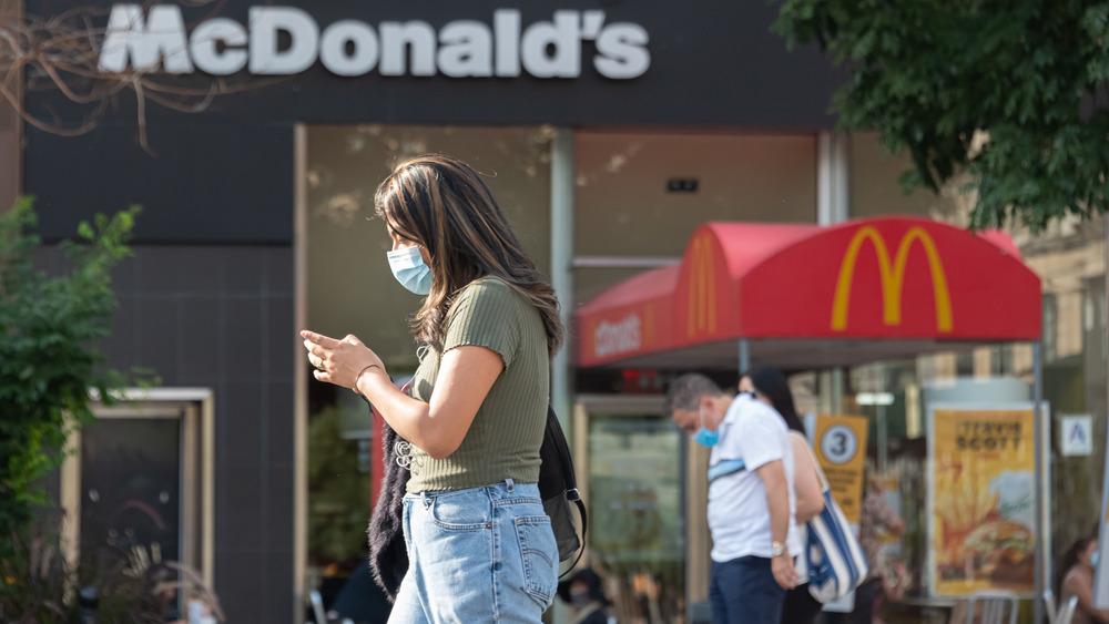 People walking past McDonalds