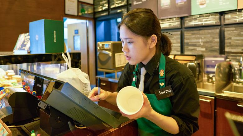 Starbucks employee at cash register