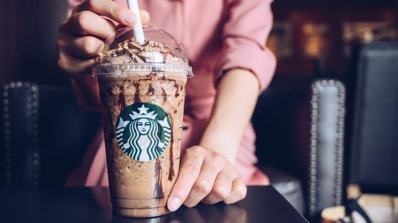Person holding Starbucks Frappuccino