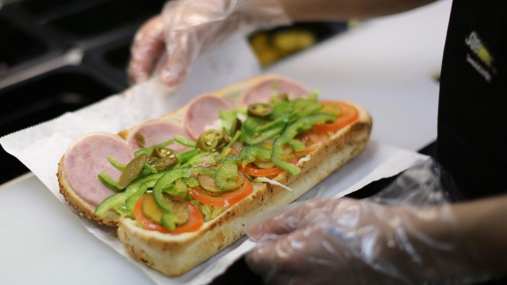Subway employee making a sandwich