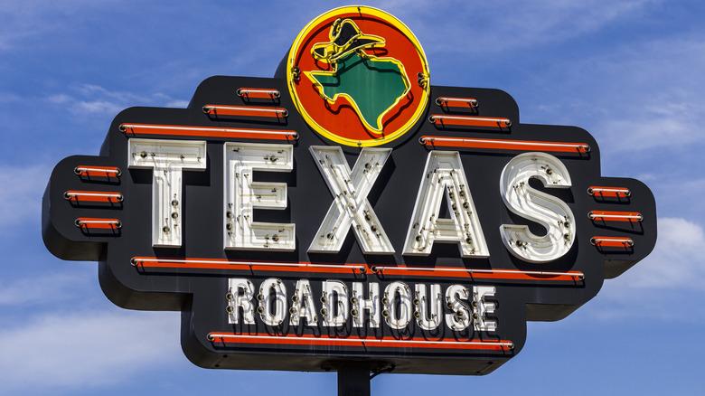 Texas Roadhouse sign against blue sky