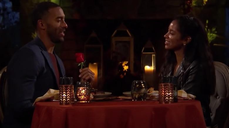 The Bachelor contestants eating dinner