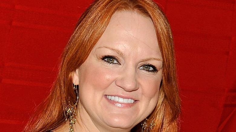 Ree Drummond smiling against red backdrop