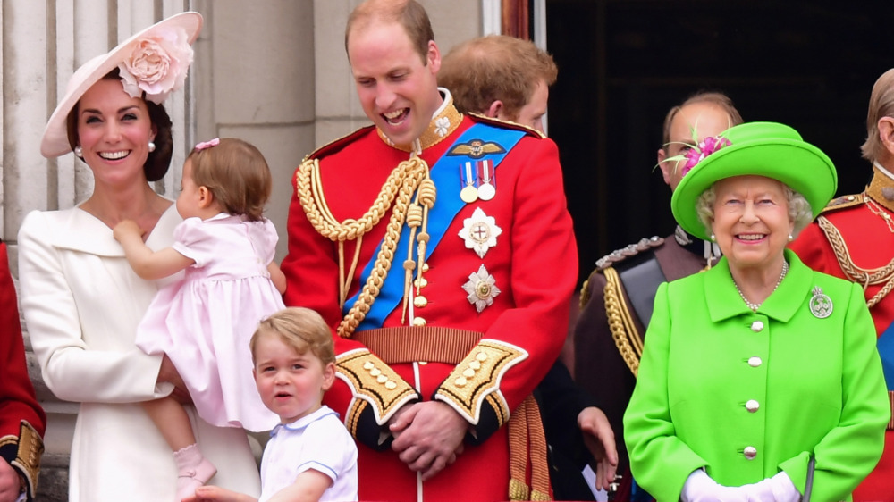 The royal family smiling at event