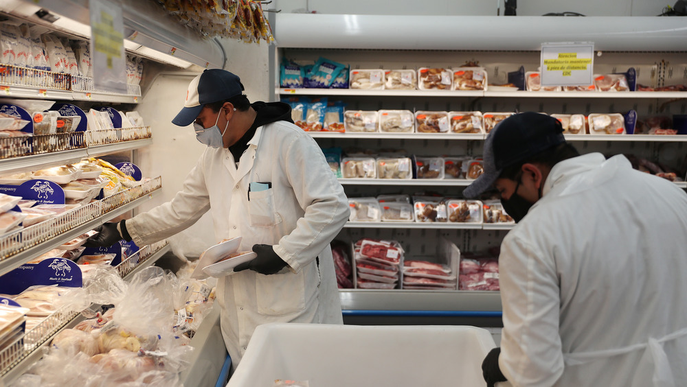 Workers restocking fresh food