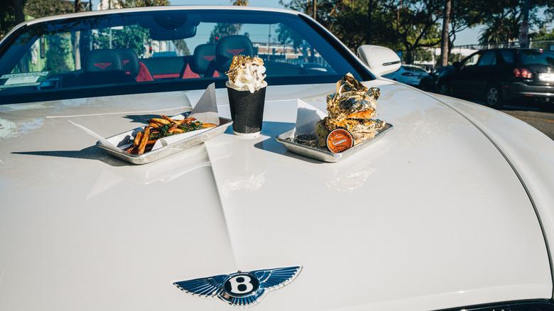 Adrift burger sits on Bentley convertible