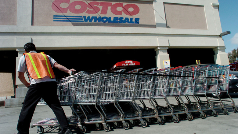 Costco worker rolling carts