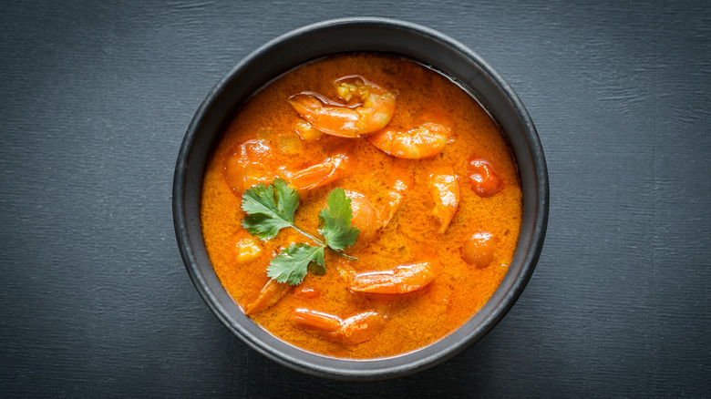 Seafood curry in black bowl