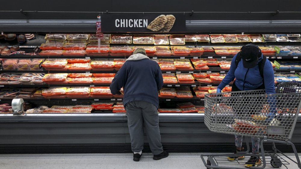 Grocery shelves with meat products