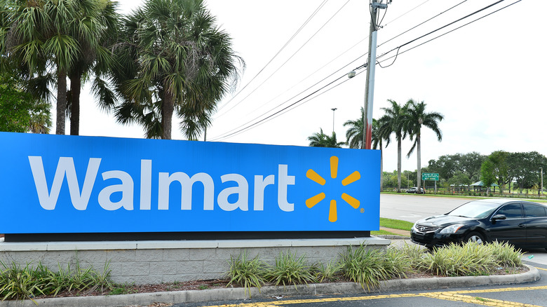 A wall of Walmart logo